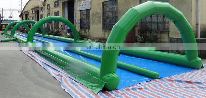 customized giant inflatable double lane water slip for sale