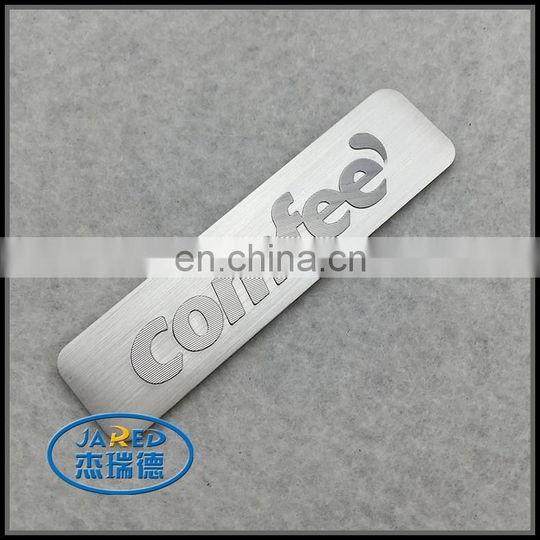 wholesale embossed logo custom brushed metal badges from china