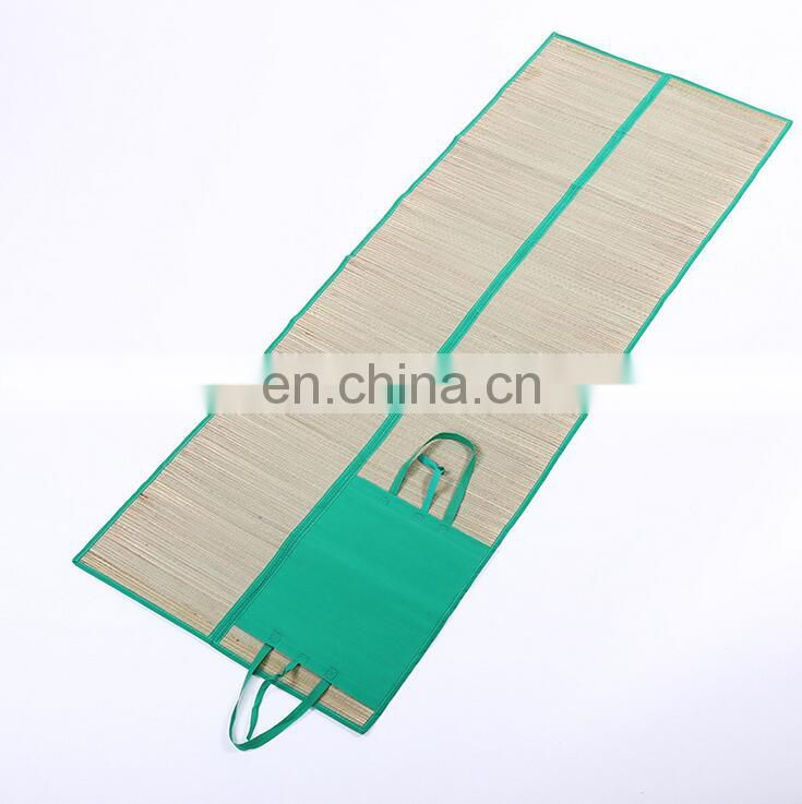 Two folds straw beach mat
