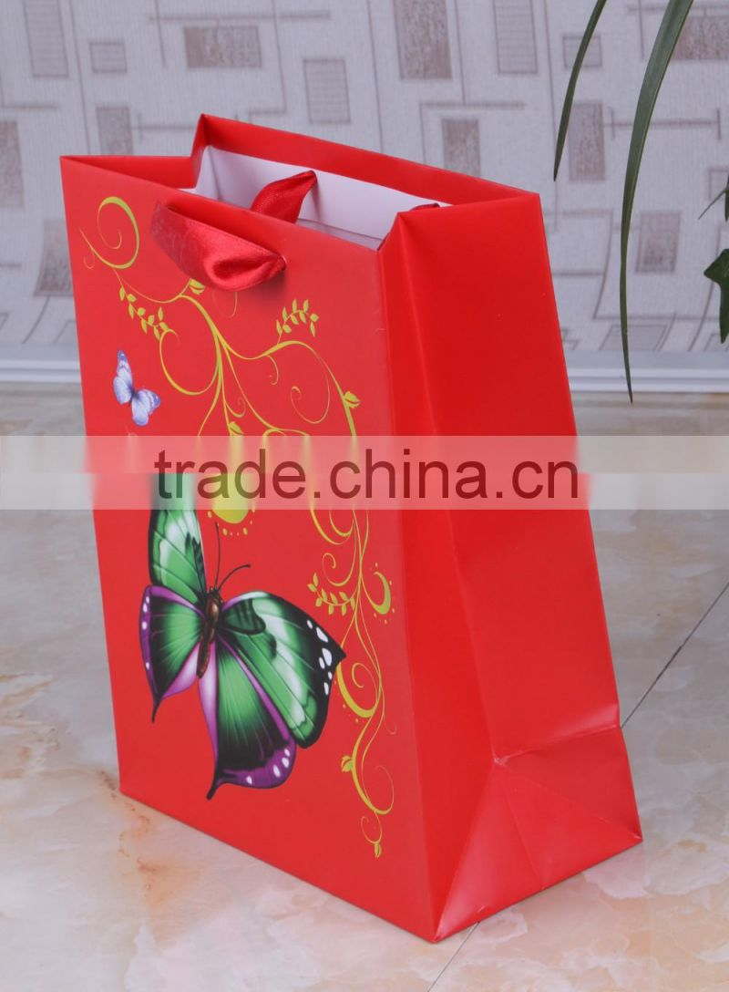 Colorful 210gsm Ivory paper gift bag with satin ribbon handle