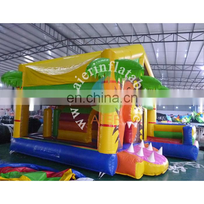 Good quality kids playground equipment inflatable jumping castle lion nemo bouncer with slide for sale
