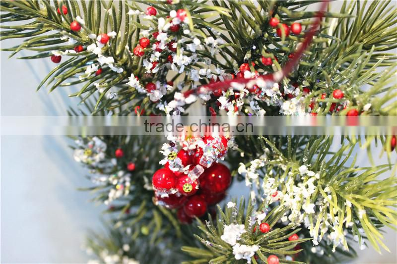 pine tree red fruit branch winter festival decorationwith snowy effect