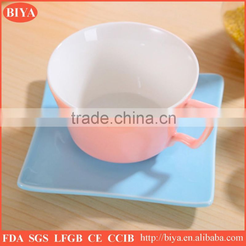 high quality color stoneware coffee cup and saucer double glazed with iron spoon for home used or gift package