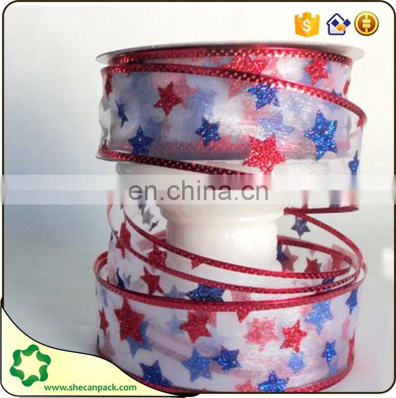 SHECAN Wired gold edged snowflake print on red organza ribbon