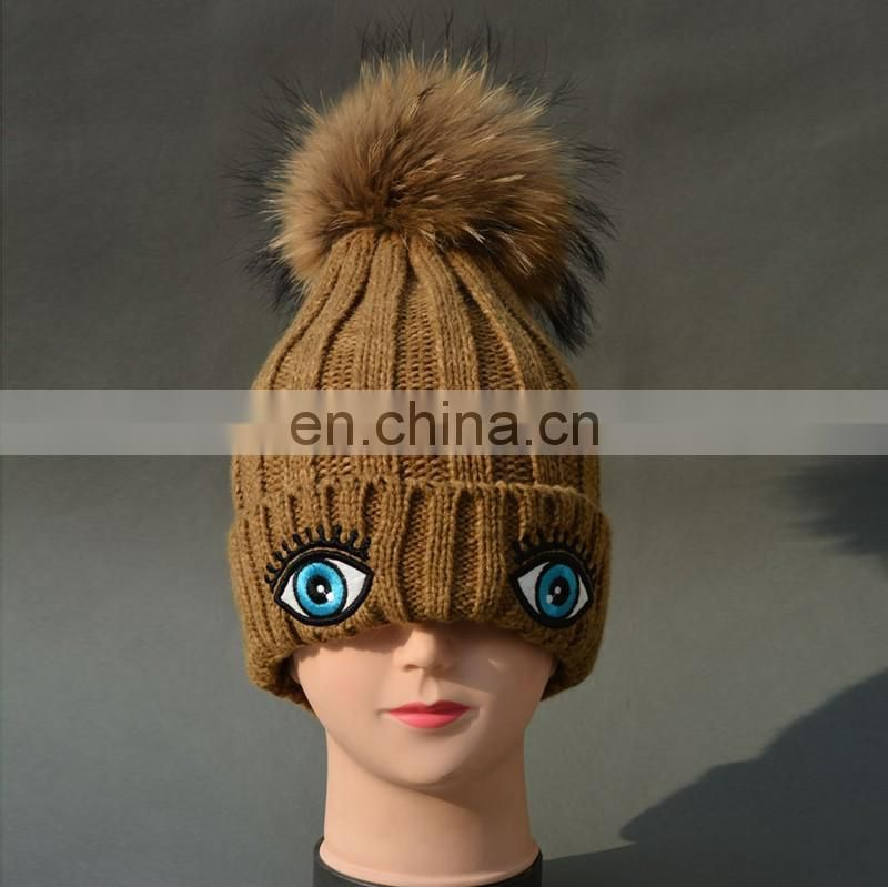 China Supplier Unisex Knitted Oxeye Embroidery Hats With Raccoon Fur Pompoms Balls Caps