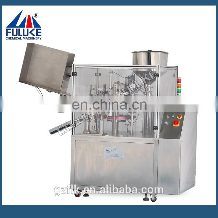 Semi-automatic cosmetic tube filling and sealing machine