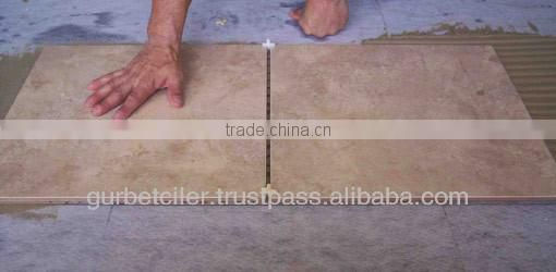 Manufacturer sizes plastic tile spacers (SG)