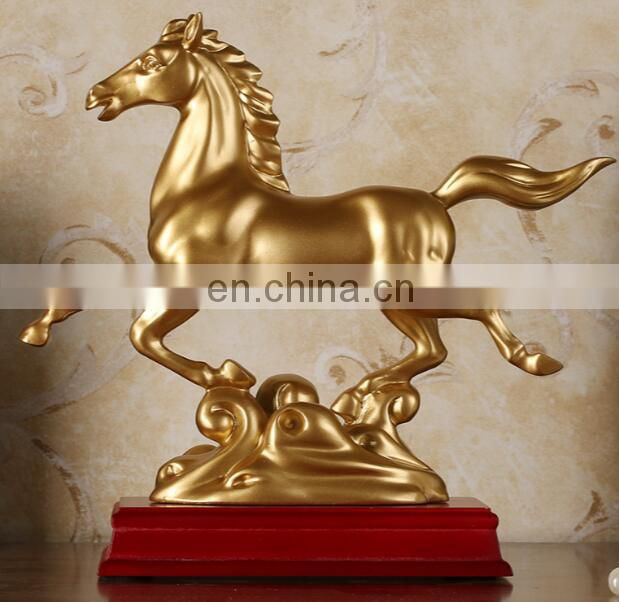 gold color resin horse statue