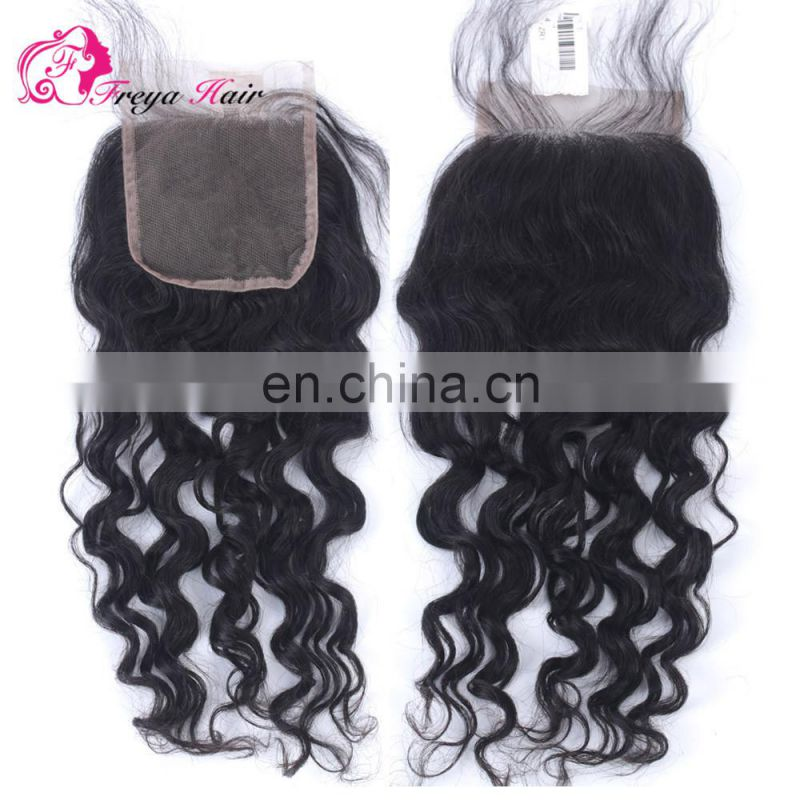 Qingdao hair factory Hot selling top brazilian hair free parting lace closure