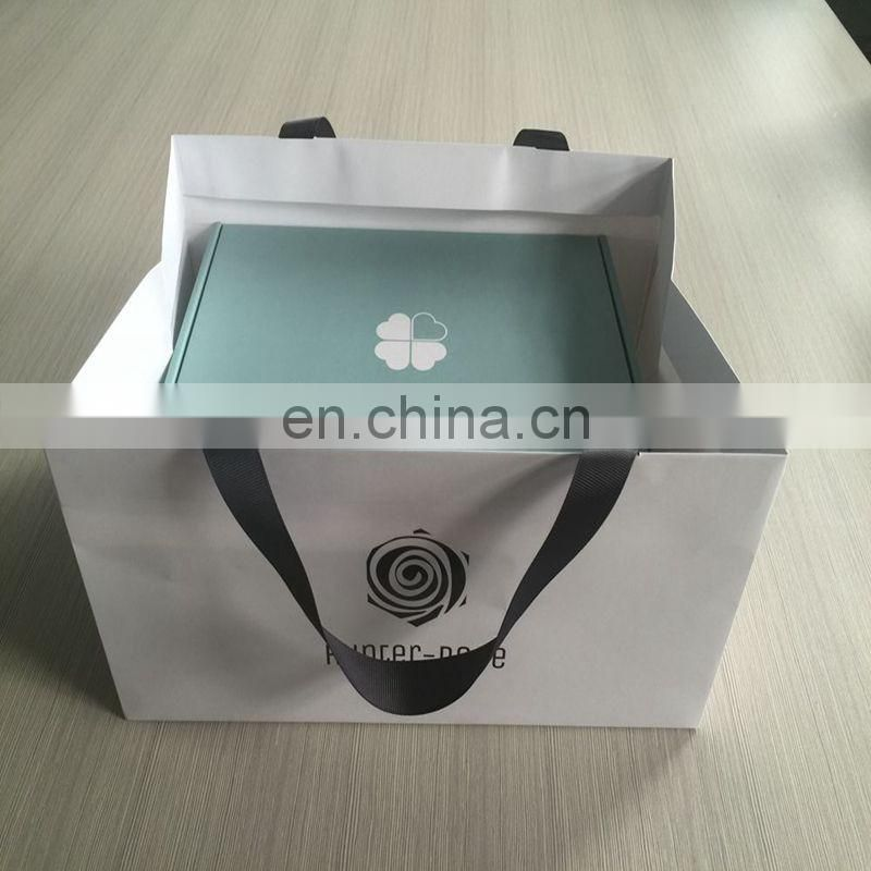 Cheap price nice design white black logo heavy paper bags