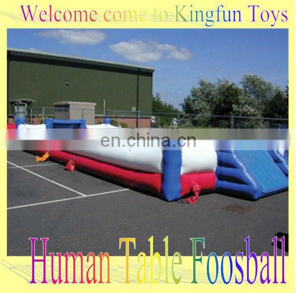 Red Inflatable human foosball yard