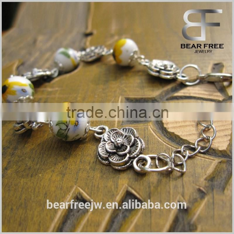Trendy Jewelry Women's Silver Flower 10mm ceramic beads silver bracelet with elastic rope 9 colors