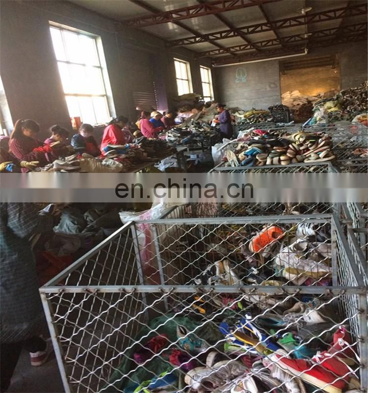 Cheap wholesale used shoes in china/second hand clothes in bales for uganda