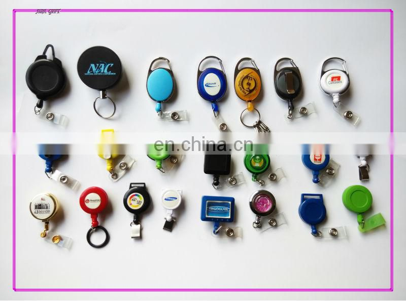 Plastic badge reel retractor