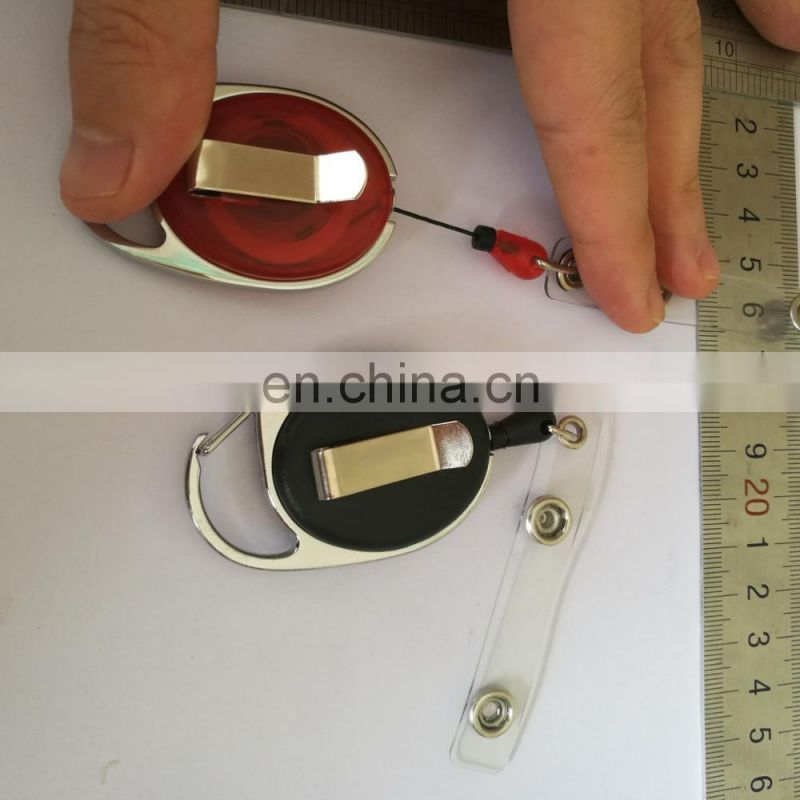 Plastic yoyo tags with carabinner frame and metal belt