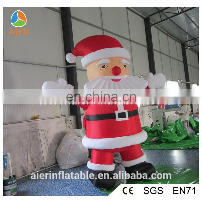 Outdoor inflatable Christmas moving Santa for sale