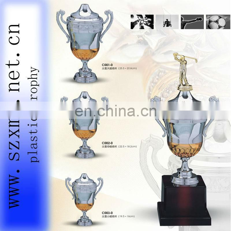 plastic trophy cup of honor with top medal for souvenir