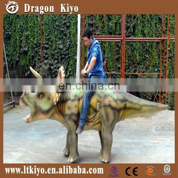 amusement park walking and riding dinosaur triceratops
