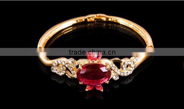 2010 Ruby Semiprecious Stone Bangle in Gold Plating