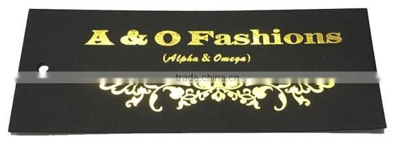 black hang tag with gold stamping