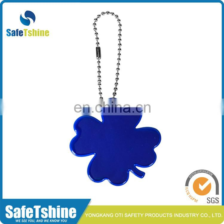 Factory wholesale cheap cute reflective pvc keychain promo