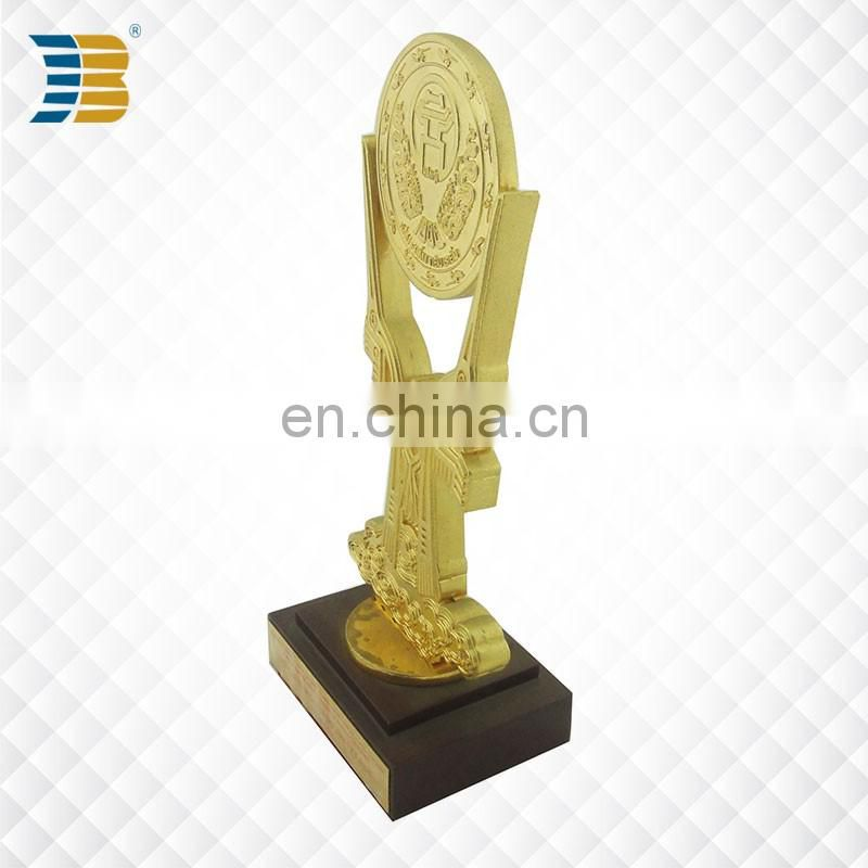 custom painted gold plated award trophy with wooden base