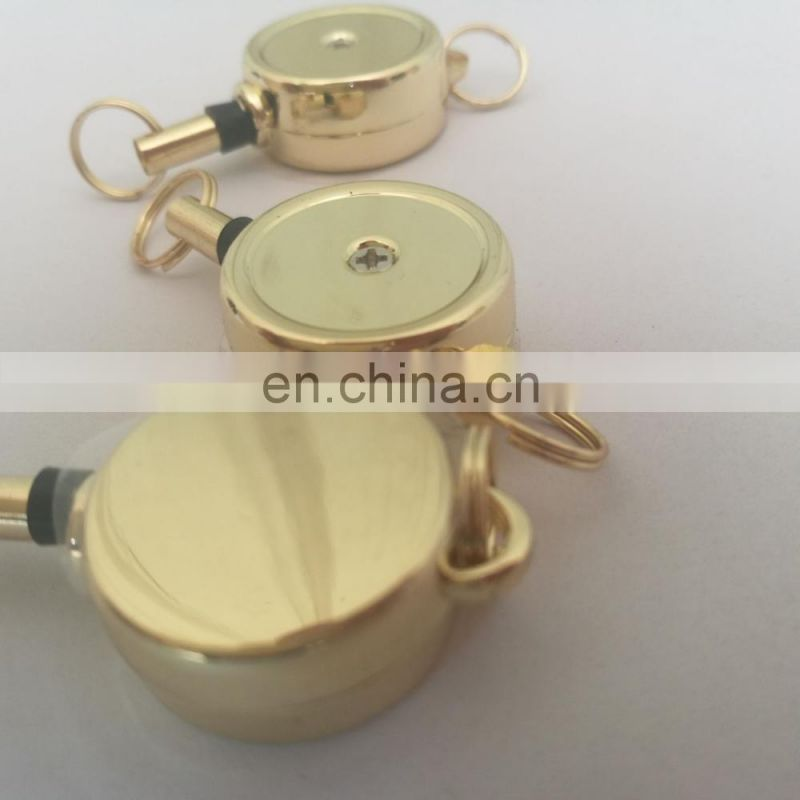 metal pull release yoyo keychain in golden color