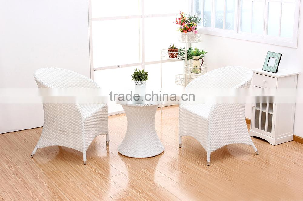 tempered glass round table set with two rattan chairs for outdoor used