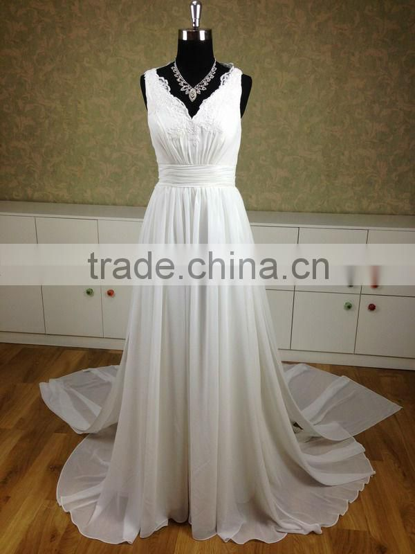 So beautiful chiffon and lace V-neckline wedding dress with a long train and backless