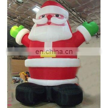 giant inflatable Santa claus with gift outdoor christmas decoration