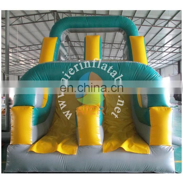 Inflatable obstacle course with double slide