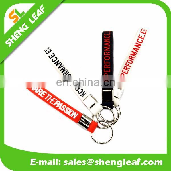 Hot sale silicone rubber bracelet key ring , 100% silicone wristband key chain , screen printing silicone keychain