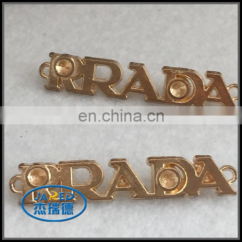 cangnan custom made cheap aluminum metal clothing badge/tag