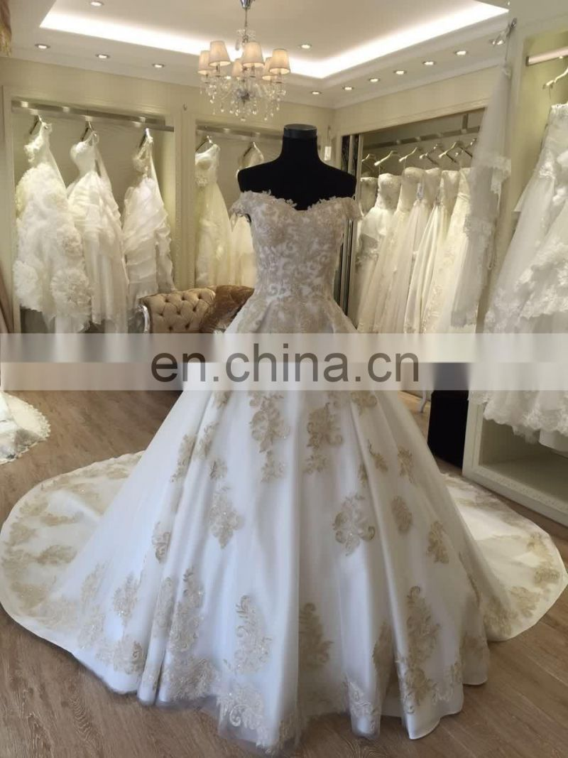 julie vino white and gold long trail wedding dress