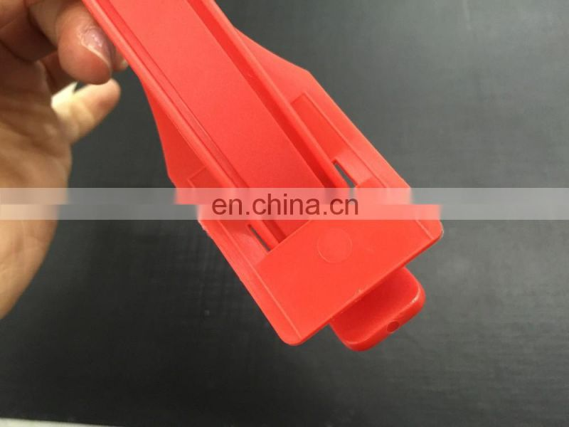 Red plastic handle for carton packing
