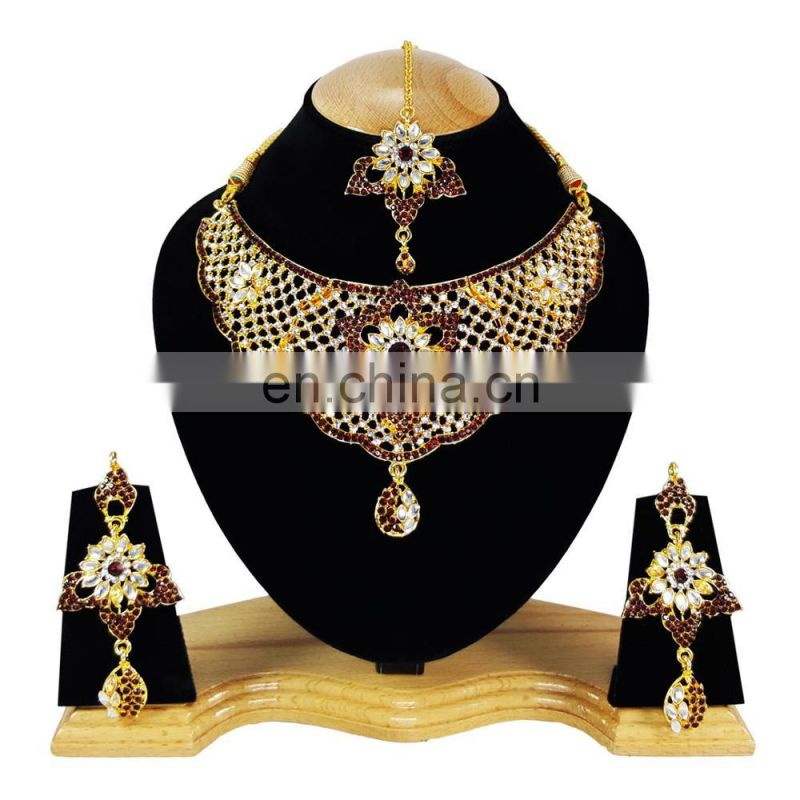 Fancy Intricate Design Dark Red Color Flower Gold Plated Kundan Zerconic Necklace Earrings Tikka