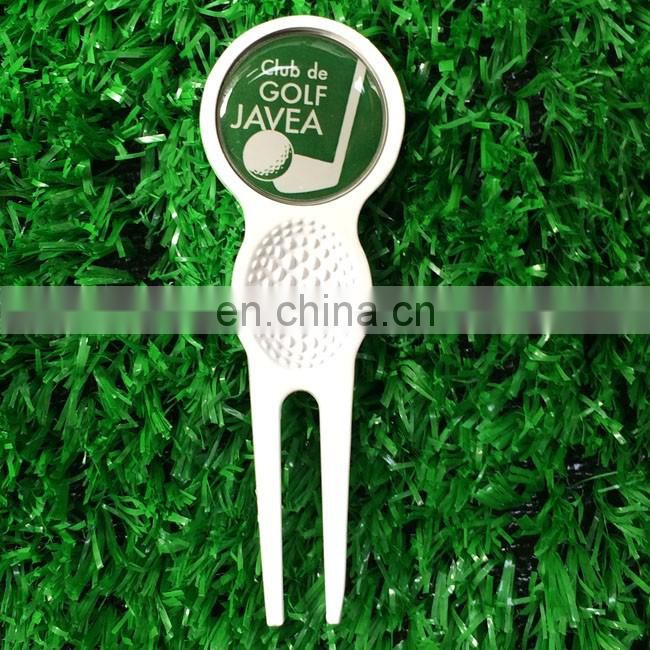 retractable Switchblade golf divot tool with ball marker
