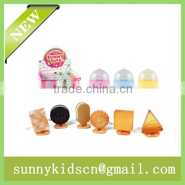 promotional wind up toy wind up cookie wind up biscuit capsule toy
