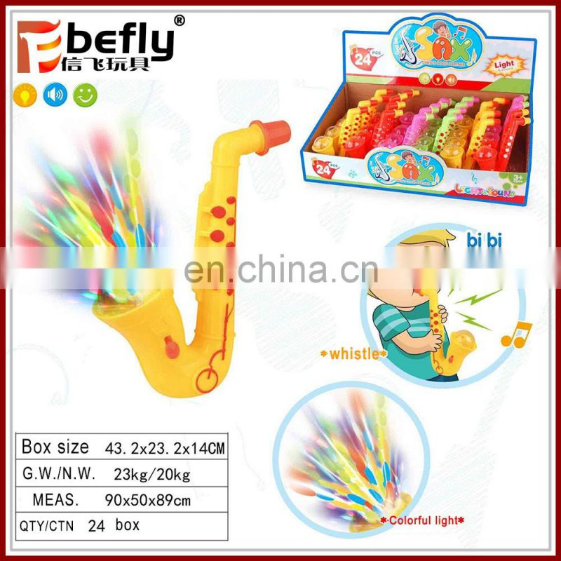 Promotional plastic saxophone candy toy with flash light