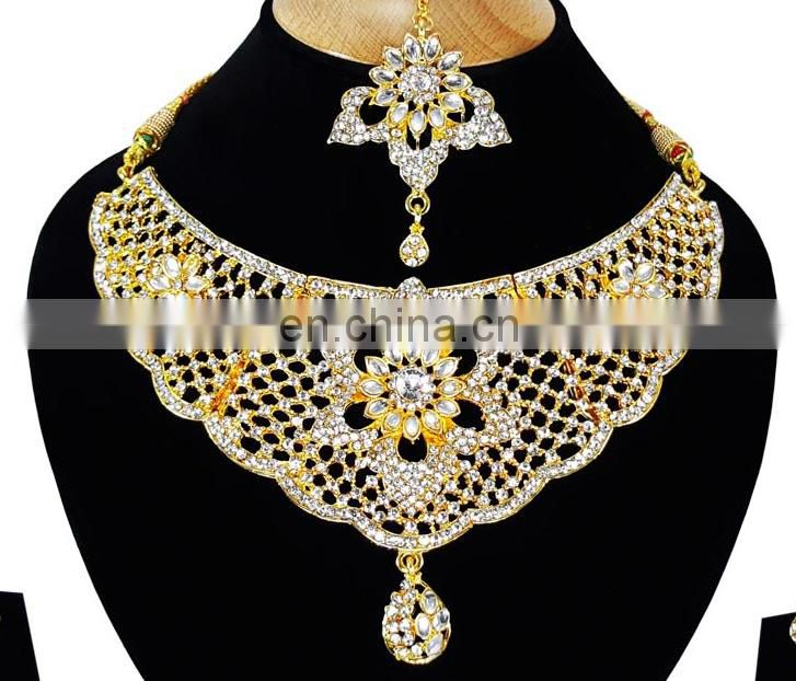 Fancy Intricate Design White Color Flower Gold Plated Kundan Zerconic Necklace Earrings Tikka