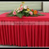 Red color brocade material reception desk use fold table skirt covers for company trade show