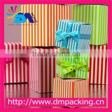 Bright and vibrant striped cardboard pretty printed cube recycled gift box