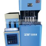 ZG-2000B hot sale 4 cavity semi automatic pet blow machine/ small plastic bottle makee machines