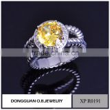 Diamond drill bit engagement ring with yellow diamond wedding ring