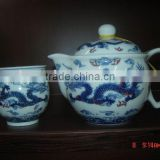 porcelain tea kettle and porcelain cup