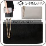 2016 leather pouch clutch bag zip fastening decorative chain hot sell plain leather hand bag simple fashion small handbag