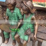 Bronze kids statues of reading with Teddy bear