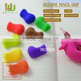 Factory direct sell silicone pencil grip soft and safe pen holder beneficiial for kids handwriting
