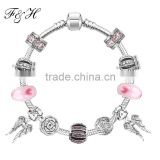 Wholesale price pink murano glass bead and angel wing pendants fit european fashion charm bracelet