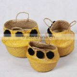High quality best selling eco-friendly Yellow seagrass baskets with black pompoms from Vietnam